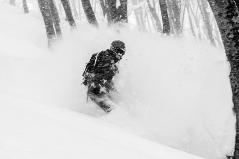 Riding deep powder between the trees in Japanese forest – Hakuba Cortina, Japan